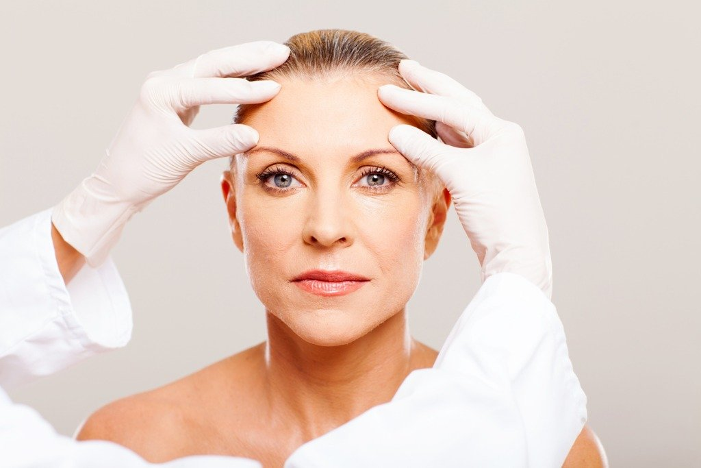A patient receiving a cosmetic consultation for oculoplastic surgery.